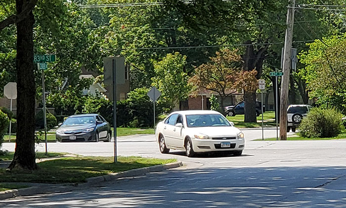 A car travels northbound on Center Avenue diagonally across four-lane 183rd Street on Saturday, July 25. The intersection was the site of a fatal two-car crash on July 22. (Eric Crump/H-F Chronicle)