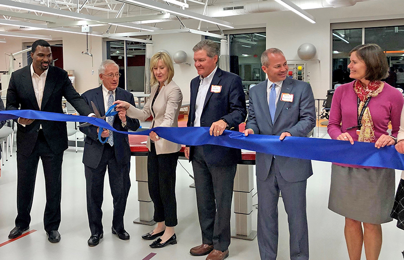Scissors in hand, Homewood Mayor Richard Hofeld and Dr. Joanne Smith, president and CEO of the Shirley Ryan AbilityLab, prepare to cut the ribbon on Oct. 22 marking the official opening of the new DayRehab Center in Homewood. (Provided photo)
