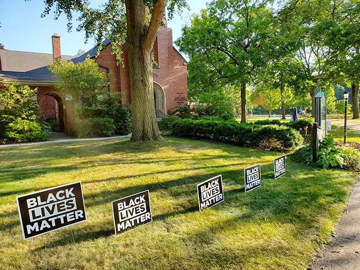 After a banner on the lawn of the Episcopal Church of St. John the Evangelist in Flossoor with a message supporting the Black Lives Matter movement was vandalized, community members brought more than a dozen of their own Black Lives Matter signs to replace it. (Eric Crump/H-F Chronicle)