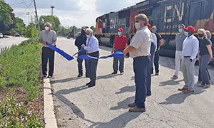 Homewood Mayor Richard Hofeld cuts the ribbon officially recognizing a new greenspace along Harwood Avenue, created in partnership between CN Railway and the village. (David P. Funk/H-F Chronicle)