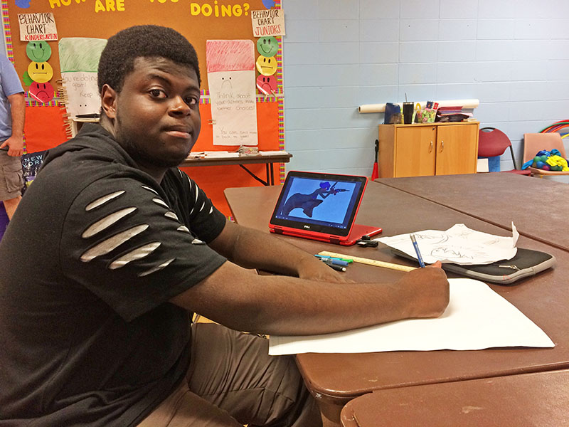 Kevin Watson, a senior at Homewood-Flossmoor High School, plotted out a character for his cartoon in the Comic Books 101 class.