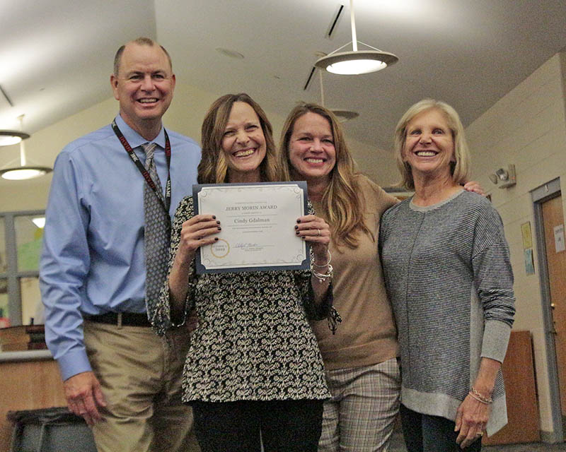 From left, District 153 Superintendent Dale Mitchell, music teacher Cindy Gdalman, Willow School Principal Melissa Lawson and District 153 Board President Shelly Marks. Gdalman was presented with the Jerry Morin Educational Excellence Award at the Oct. 15 board meeting. (Eric Crump/H-F Chronicle)