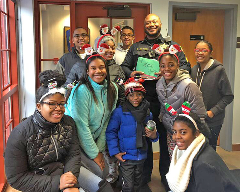 Members of You Matter 2 deliver cookies to Glenwood police, one of the organization's community service projects. (Provided photo)