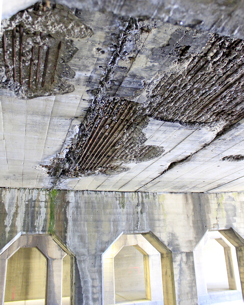 The nearly century-old viaduct is showing its age with crumbling concrete over the roadway. (Eric Crump/H-F Chronicle)