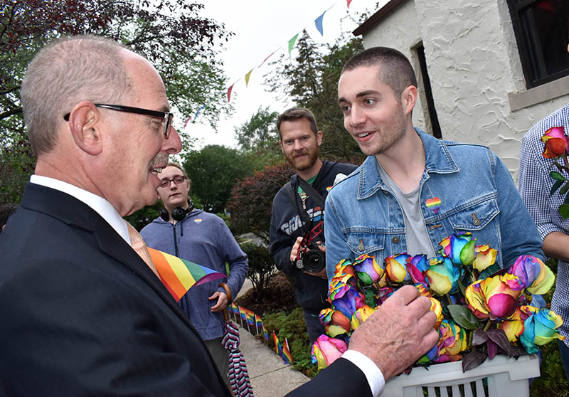 Paul Braun, mayor of Flossmoor, checks out the rainbow roses held by Jimmy Austin of Homewood during the 2018 Pride Party in Flossmoor. (Chronicle file photo)