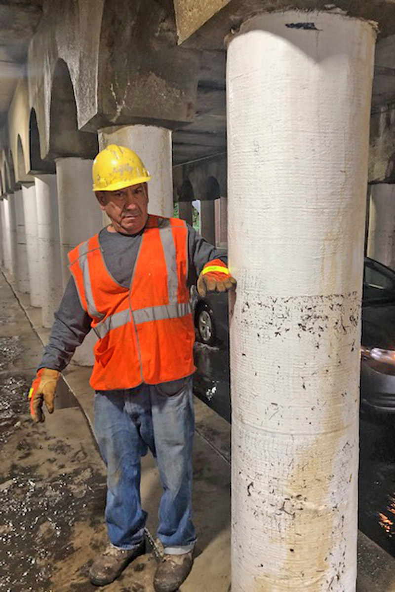 A Metra worker shows the high water mark in a portion of the Flossmoor Road viaduct, the result of intense thunderstorms Friday night. (Provided photo from Tom Dobrez)