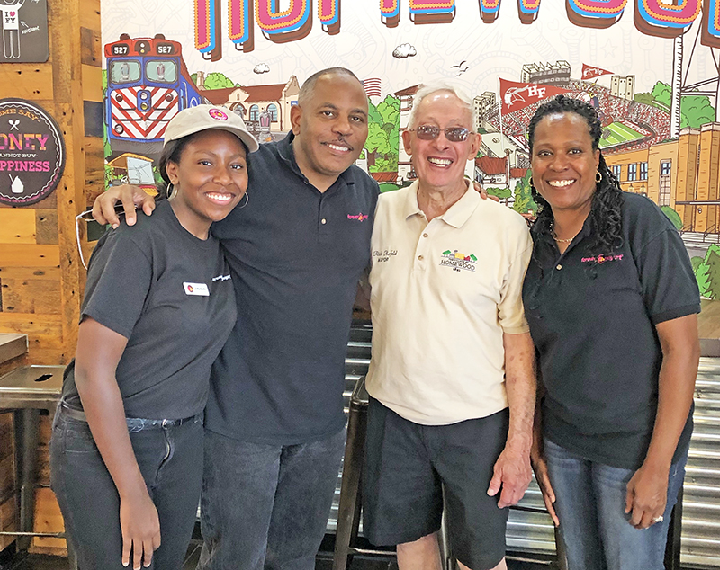 From left, Jaida Fourte, her dad, Kevin Fourte, Homewood Mayor Richard Hofeld and Josette Fourte. Josette and Kevin Fourte are owners of Forever Yogurt in Homewood. (Provided photo)