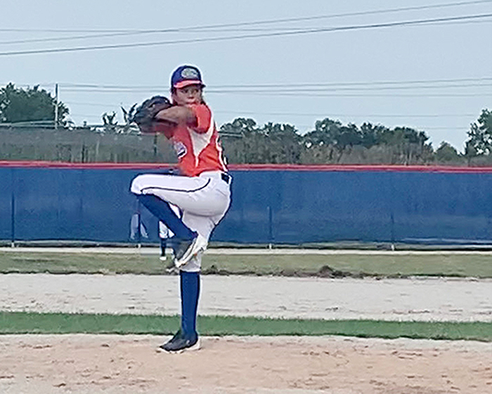 Demi Chaney of Homewood pitches for the Gators, an all-girl baseball team, during a tournament in Lynwood over the Labor Day weekend. (Provided photo)
