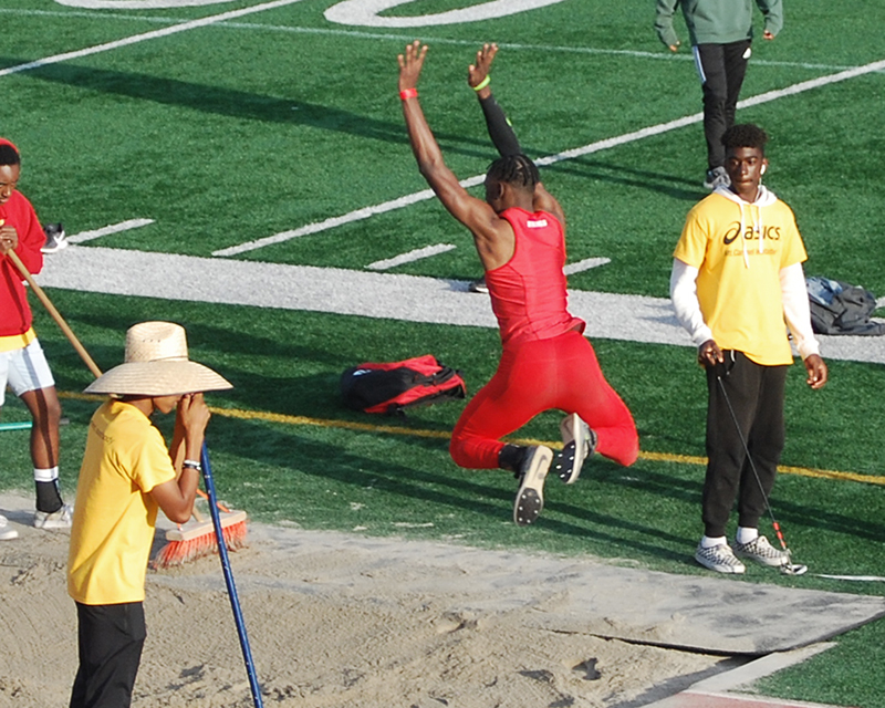 H-F's Quinton Stringfellow prepares to land his record-setting long jump at the ASICS Invitational.
