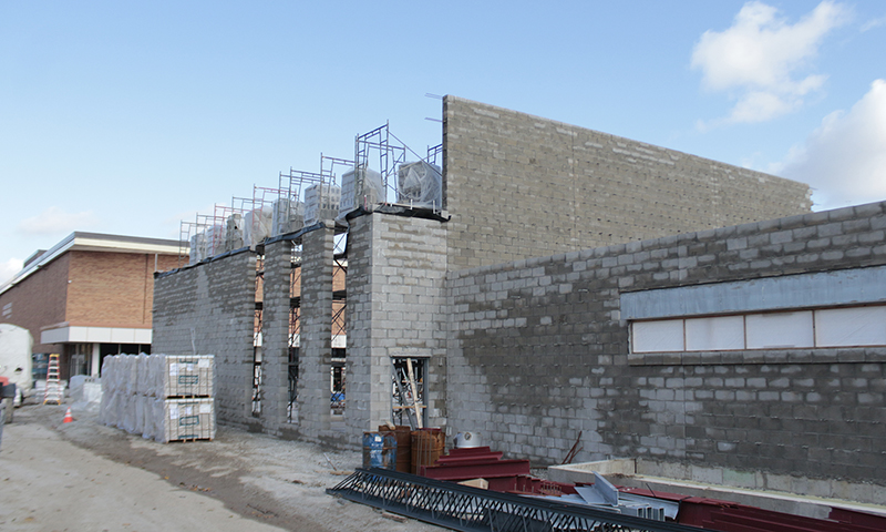 Walls are going up on the Homewood-Flossmoor High School fine arts addition south of the Mall Theatre. (Eric Crump/H-F Chronicle)
