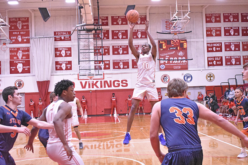 Senior forward Maurion Scott pulls for a jumper in the first quarter. Scott tallied up 15 points, five rebounds and three assists. (Donald Crocker/H-F Chronicle)