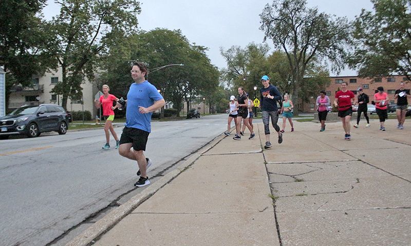 Members of the HF Community Running Club head out for a run along the route of the Hidden Gem Half Marathon shortly after 7 a.m. on Saturday. (Eric Crump/H-F Chronicle)