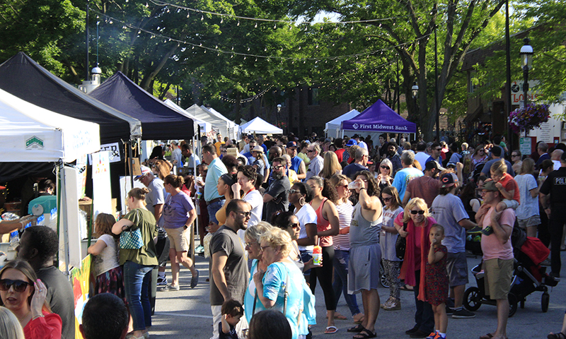 The Artisan Street Fair draws a big crowd, as seen in this photo looking south on Martin Avenue during the 2019 event. The festival has been moved to September this year because of the COVID-19 pandemic and will be held in conjunction with Fall Fest. (Chronicle file photo)