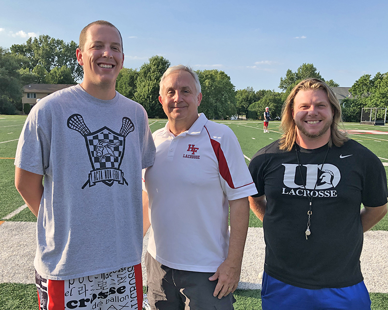 Homewood-Flossmoor High lacrosse team practice sessions were supervised by, from left, assistant coach Jason Keane, head coach Mark Thompson, and H-F graduate and visiting coach Josh Berey-Wingate from the University of Dubuque.