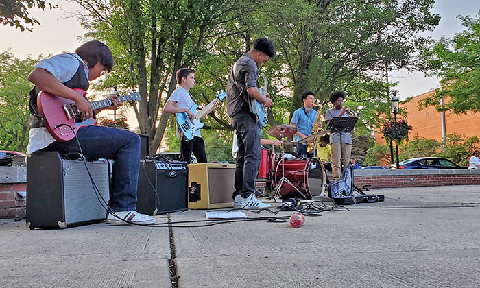 The Park Sessions band on July 2 included, from left, Manny Gonzalez, guitar; Sam Calhoon, bass; Kendall Carter, guitar;  Will Lawton on drums (behind Carter), Ken Nakamura, saxophone; and Winston Doss,  trumpet. (Eric Crump/H-F Chronicle)