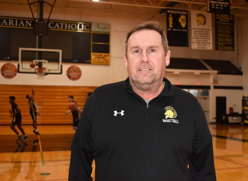 Marian Catholic High School basketball coach Mike Taylor's record is 300 victories in his career.