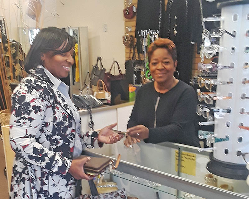 Customer Catherine Greenlee, of Homewood, chats with Brenda Livingston, owner of Maxine's Boutique. (Sharon L. Filkins/H-F Chronicle)