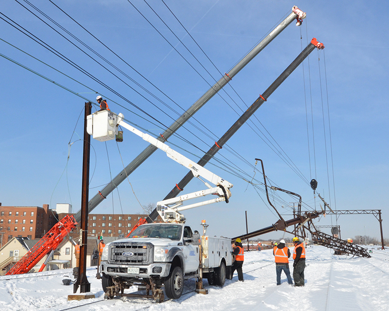 Crews examine the damaged support structure hit by a CN freight train Wednesday, Jan. 30, shutting down Metra traffic.