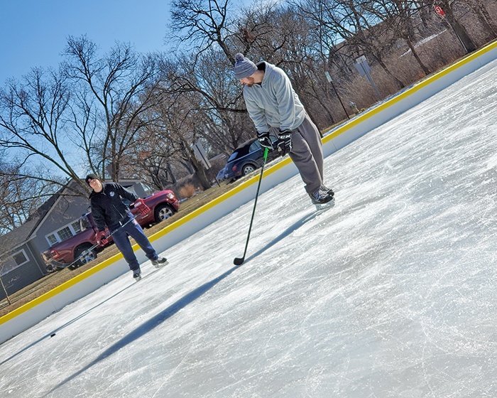 From left, Alex Tessari of Tinley Park and Tom Rodeghier of New Lenox practice hockey on the east ice rink at Flossmoor Park. (Eric Crump/H-F Chronicle)
