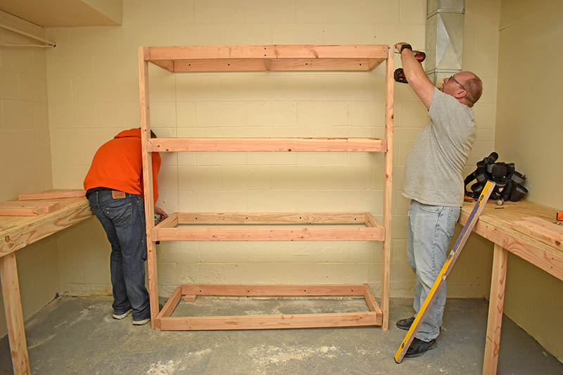 Father and son team Max and David Gilmore volunteer their time to make shelves for a clothing closet inside Overflow Ministry at the Korean United Methodist Church, 19320 Kedzie Ave. in Homewood. Volunteers are accepting donations of like new or new clothing, toiletries and household items.