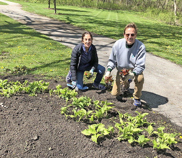 Lynn and Barry Gaby of Flossmoor sent the morning planting the flower bed at Pheasant Trail Park. (Marilyn Thomas/H-F Chronicle)