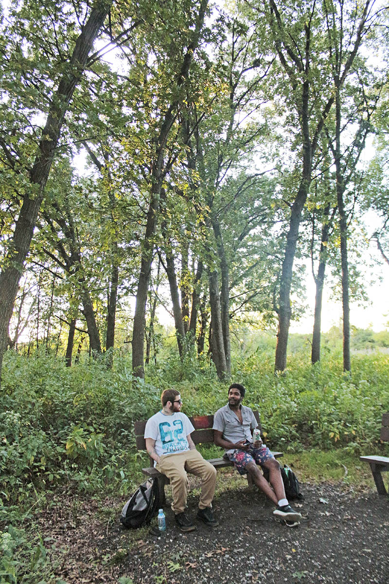 Jordyn McGrath, left, of Chicago Heights, and Philander Crawford of Glenwood enjoy the tranquility of the oak woodland recently at Izaak Walton nature preserve in Homewood. (Eric Crump/H-F Chronicle)