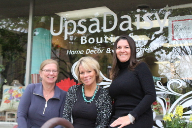 UpsaDaisy owners, from left, Suzy Moore, Julie Smith and Julie Lawton, opened the boutique in March 2015. In May 2016, they purchased the building, making an investment in the rebirth of downtown Homewood.