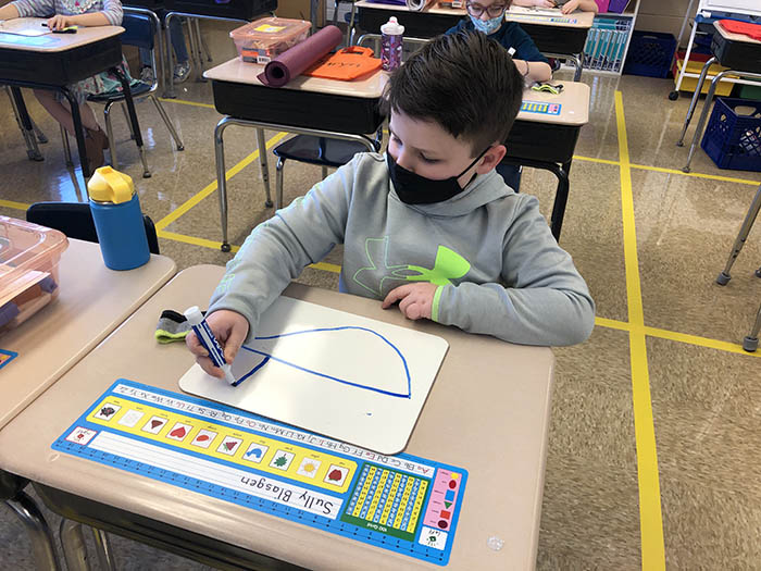 Sully Blasgen's teacher gave the class time to draw and he worked on the Titanic. Afterward, his white board was used for math problems. (Marilyn Thomas/H-F Chronicle)