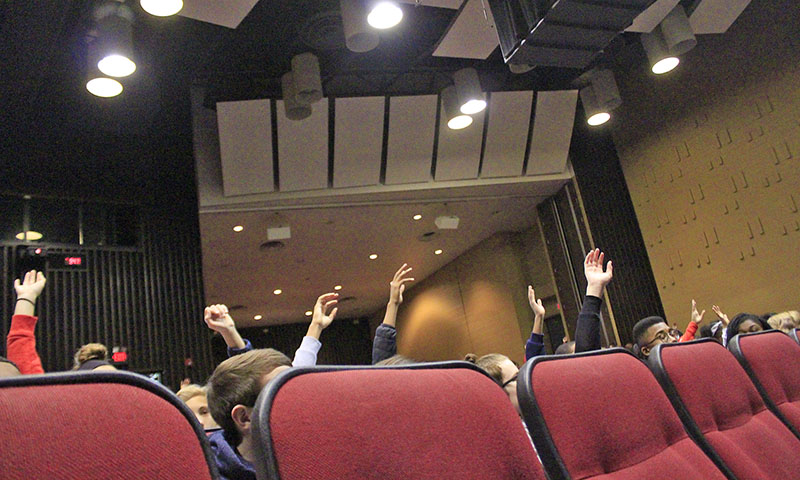 Students raise their hands when presenter Richard Wistocki asks which social media platforms they use.