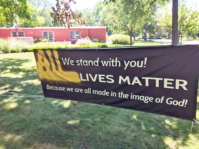 Graffiti changes the message of a banner at the Episcopal Church of St. John the Evangelist in Flossmoor expressing support for the Black Lives Matter movement. (Provided photo)