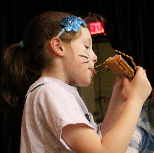 Teagan Meeks digs into a gooey s'more at the 2017 Chocolate Fest. (Chronicle file photo)