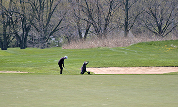 A golfer lines up a shot at Coyote Run on May 1, the first day courses were open after a six-week closure due to the COVID-19 pandemic. (Chronicle file photo)