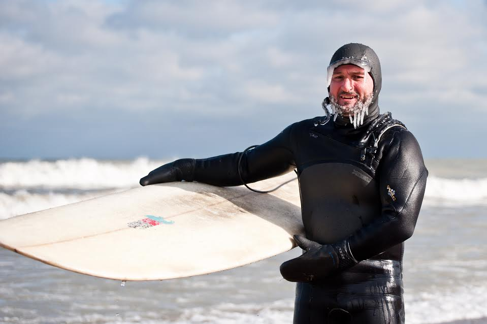Despite freezing temperatures, winter is the best time for surfing in Lake Michigan because of strong storm systems, according to Homewood resident Dave Benjamin. (Provided photo)