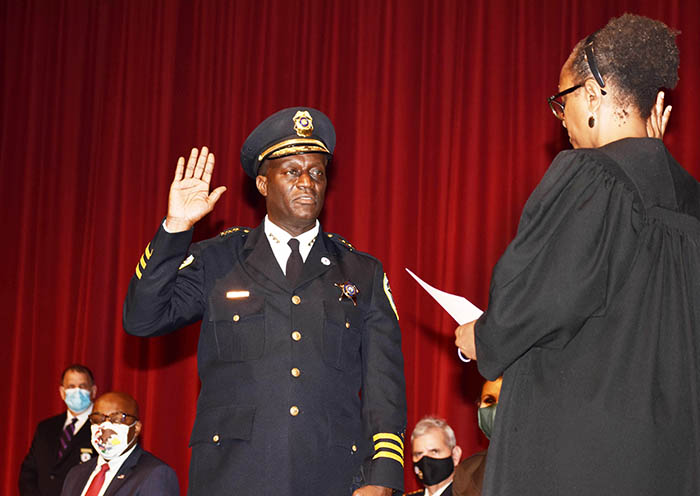 Mitchell R. Davis, Hazel Crest police chief, gets sworn in April 30 as the new president of the Illinois Association of Chiefs of Police. His cousin, Judge Toya Harvey administers the oath of office. (Mary Compton/H-F Chronicle)