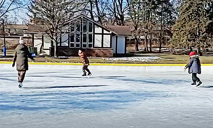 From left, Amie, Owen and Sam Day of Flossmoor get some fresh air on Saturday, Jan. 23, at the Flossmoor Park ice rinks. (Eric Crump/H-F Chronicle)