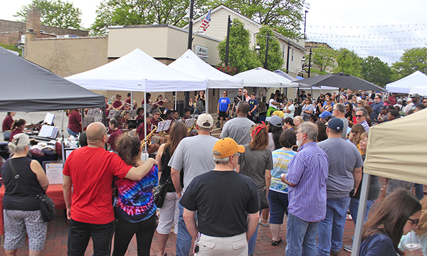 A crowd gathers as the James Hart band performs at opening day of the 2019 Homewood Farmers Market season. The market will open June 16, but no scene like this will be possible with safety restrictions in place due to the COVID-19 pandemic. (Chronicle file photo)