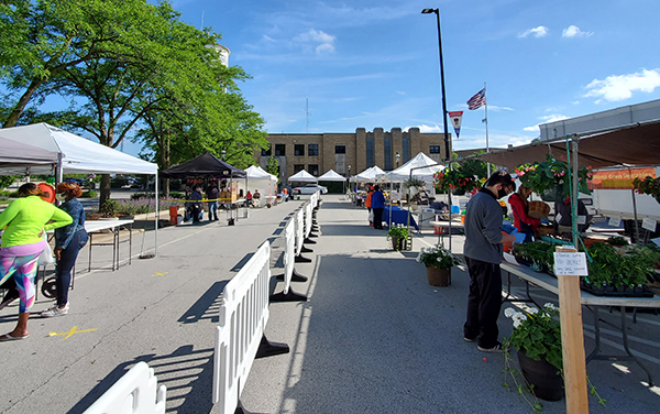 Social distancing is maintained during the first Farmers Market of the season on Saturday, June 13. Initially, no one under 16 was allowed in the market because of capacity limits, but market officials have decided to allow infants and small children in strollers to attend. (Eric Crump/H-F Chronicle)
