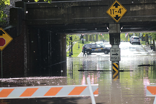 The Flossmoor viaduct is flooded after heavy rains in late May. Flossmoor is setting out on a plan to solve flooding at the viaduct and adjacent neighborhoods. (Chronicle file photo)