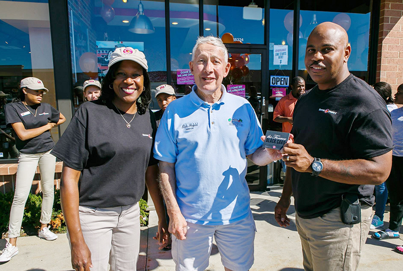 From left, Josette Fourte, Homewood Mayor Richard Hofeld and Kevin Fourte at the ribbon cutting five years ago for the Fourte's business, Forever Yogurt. (Provided photo)