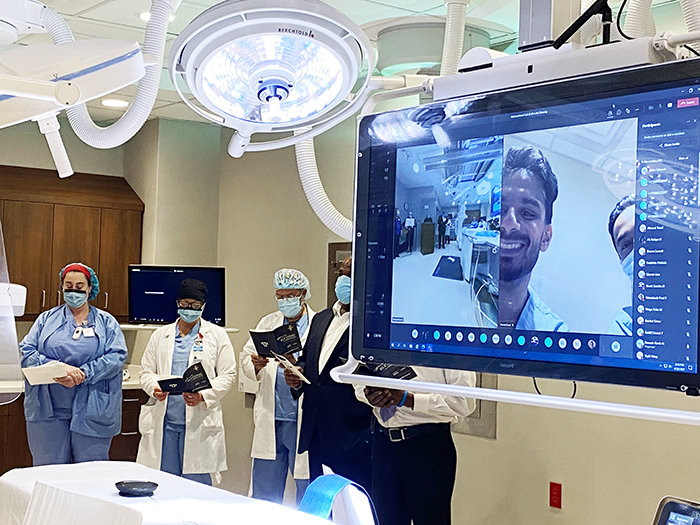 Staff gathered in person and virtually for a blessing of the new state-of-the-art interventional/catheterization lab on April 22 at Franciscan Health Olympia Fields. (Provided photo)