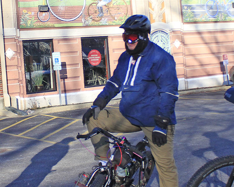 Nate Steiner is bundled up and ready to start a ride on a cold February morning. He participates often in a weekly ride sponsored by GoodSpeed Cycles in Homewood. (Eric Crump/H-F Chronicle)
