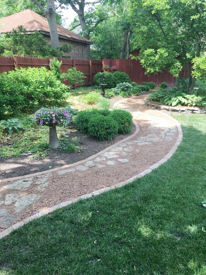 Carefully positioned ornamental bushes and trees make Chris Steiner's manicured garden spaces extra special. (Provided photos)
