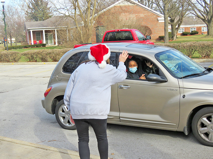 Staff members at Glenwood Academy got in the holiday spirit while giving gifts to families. (Provided photo)
