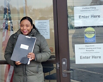 First time candidate Monica Gordon poses with nominating petitions in Springfield. The Flossmoor resident collected 2,500 signatures in order to be on the ballot for the 40th District of the state senate. (Provided photo)