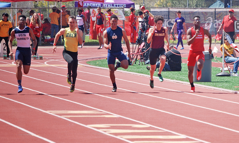 Sophomore Ugo Anidobu, at right, competes in the 100m dash at the ASICS Mount Carmel Invitational in March. He was one of 45 competitors.