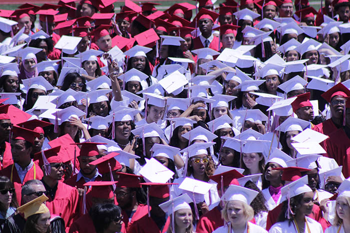 Homewood-Flossmoor High School graduates await their chance to walk across the stage and receive their diplomas during the 2018 graduation ceremony at Viking Stadium. (Chronicle file photo)
