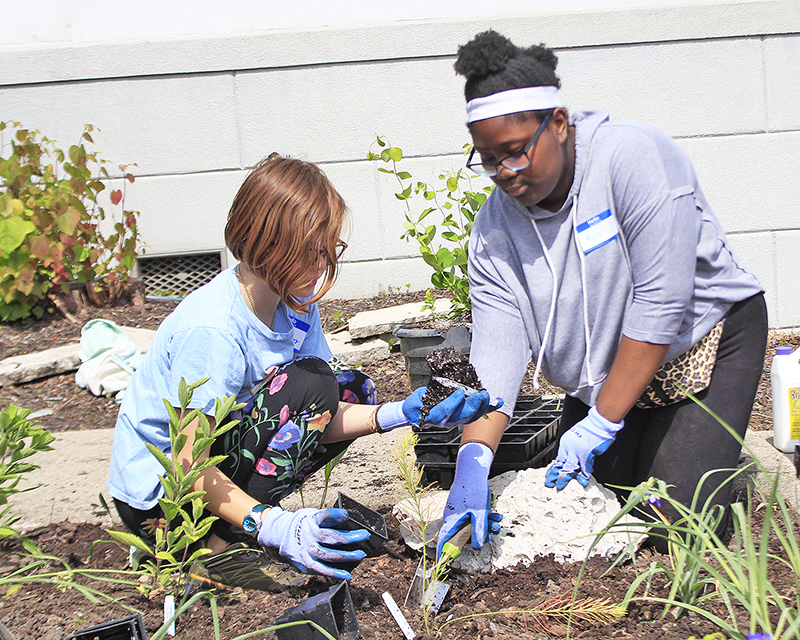 Haley Maharry, left, and Asia work together to help plan a pollinator garden at the Homewood Science Center on June 8. (Eric Crump/H-F Chronicle)
