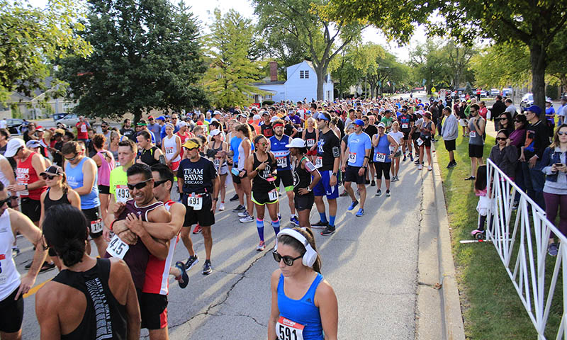 Runners, shoulder to shoulder, wait for the start of the first Hidden Gem Half Marathon on Sept. 7, 2019, months before the COVID-19 pandemic forced the implementation of social distancing requirements. Organizers cite the pandemic as the reason for canceling this year's race. (Chronicle file photo)