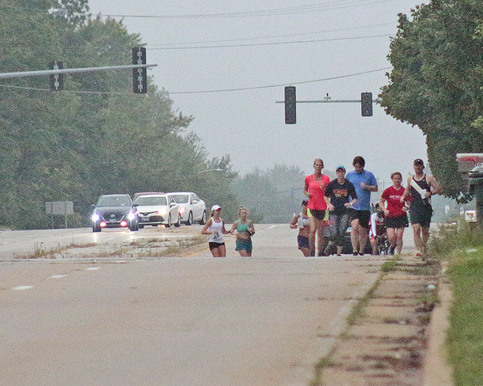 Runners head north on Kedzie Avenue briefly while following the route of the Hidden Gem Half Marathon in an unofficial race on Saturday. (Eric Crump/H-F Chronicle)