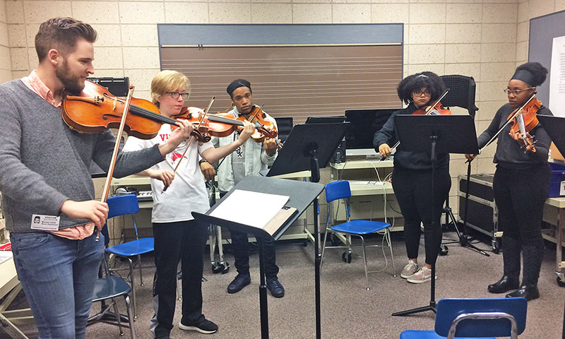 Michael Zahlit, a member of the Illinois Philharmonic Orchestra's viola section, worked with H-F students on a piece to be performed at the 7 p.m. May 21 concert. (Provided photo)